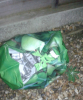 Shopping bag of identical items left in alleyway