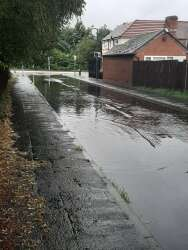 Drains blocked road flooding badly, 30th July