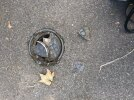Broken drain cover on pavement outside 16 Ferry Lane