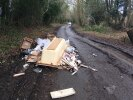 Large amount of rubbish fly-tipped on the road.