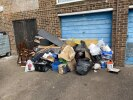 Fly tipping up against Number 4 garage door