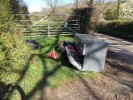 Rubbish dumped in gateway/passing place in lane