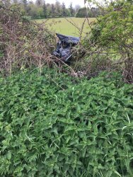Black refuse bag dumped in hedgerow in second lay-by., 3rd May