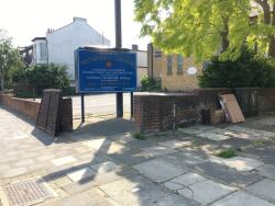 Fence panels and cardboard boxes dumped outside church, 5th June