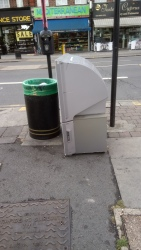 Large TV dumped on pavement, 20th August