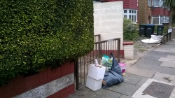 Rubbish dumped at the entrance to the alley way between Parkside terrace and Harrington terrace N18, 20th September